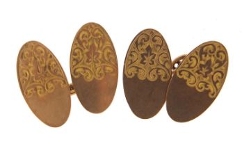 Pair of 9ct gold cufflinks with engraved decoration housed in a W Pyke & Son velvet and silk lined