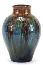 Christopher Dresser for Linthorpe Pottery, Arts & Crafts vase having a mottled glaze incised with