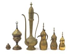 Middle Eastern metalware including a Turkish incense burner and coffee pots, the largest 60cm