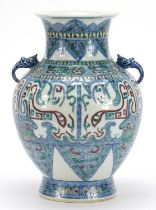 Chinese doucai porcelain vase with handles, hand painted with mythical faces and heads, six figure