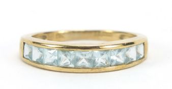 9ct gold blue stone half eternity ring, size R, 2.7g :For Further Condition Reports Please Visit Our