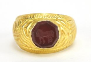 Antique unmarked gold intaglio seal ring carved with a horse, (tests as 15ct+) size U, 5.6g : For