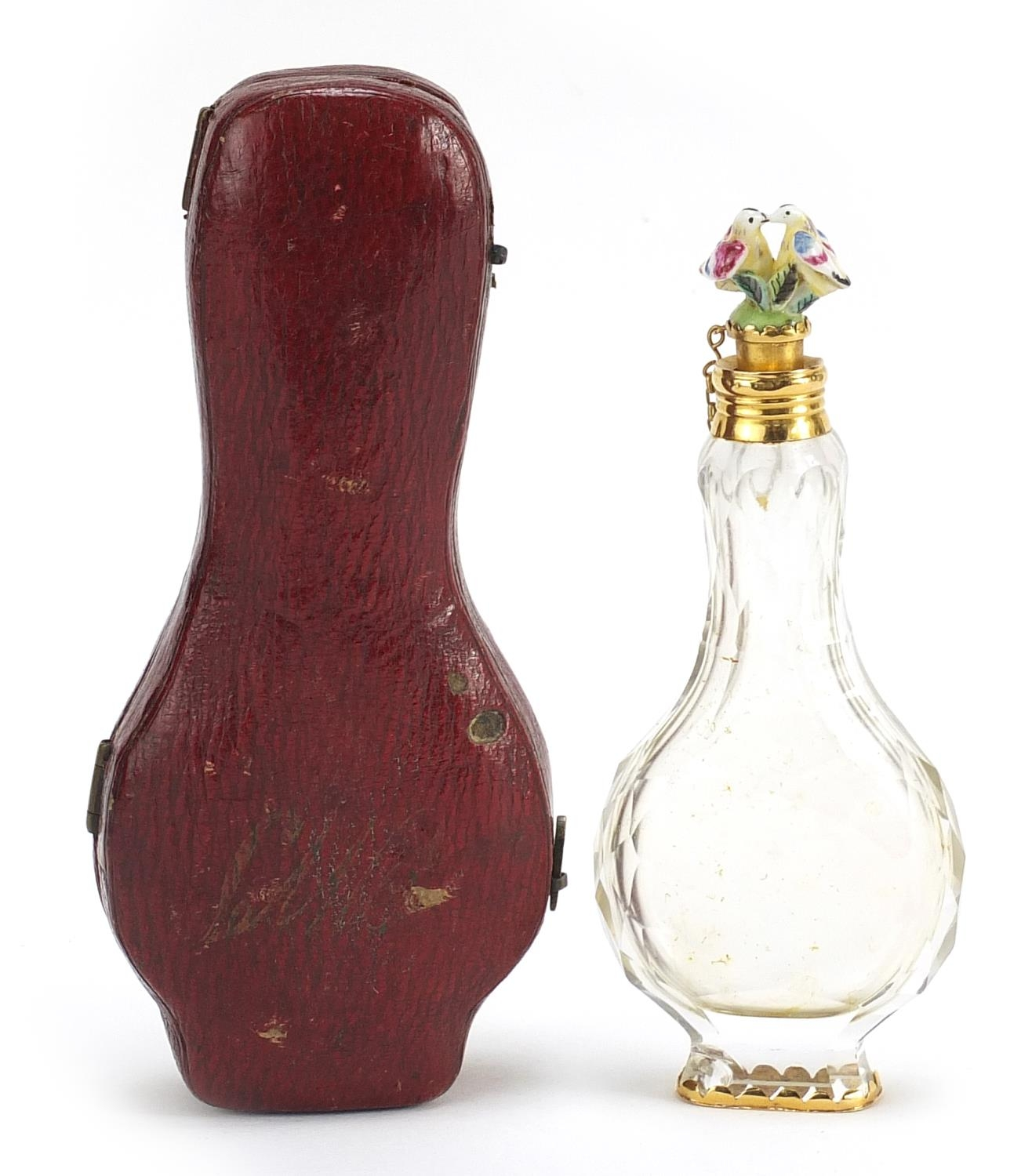 Antique cut glass scent bottle with Chelsea style porcelain bird stopper and gilt metal mounts,