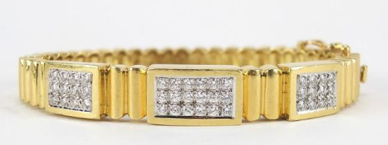 18ct gold diamond cluster hinged bangle, set with forty two diamonds the diamonds approximately 2.