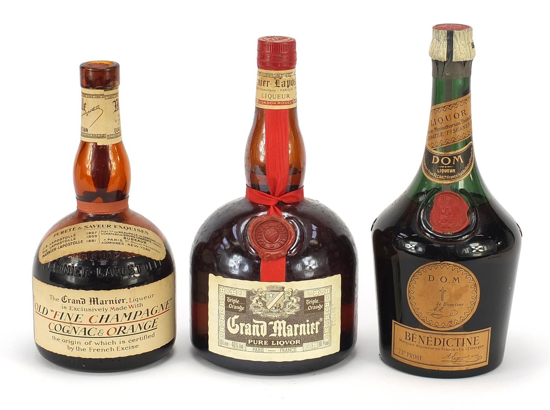 Three vintage bottles of liqueur comprising Grand Marnier Old Fine Champagne Cognac and Orange,