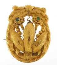 Large unmarked gold naturalistic brooch (tests as 9ct gold) set with green stones, possibly