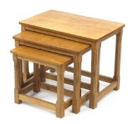 Robert Mouseman Thompson, nest of three adzed oak occasional tables, each carved with a signature