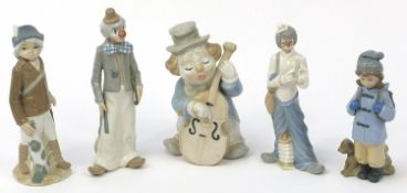 Five Spanish porcelain figures, one Nao including two clowns, the largest 24.5cm high : For