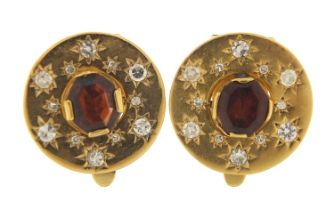 Pair of continental unmarked gold diamond and garnet clip on earrings, (tests as 15ct+ gold) 1.8cm