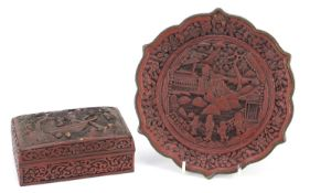 Chinese cinnabar lacquer plate and box with cover, each carved with figures, the largest 21cm in