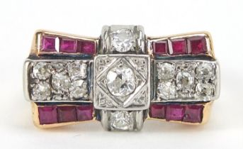 Art Deco unmarked gold diamond and ruby ring of bow design, (tests as 15ct+ gold) the central