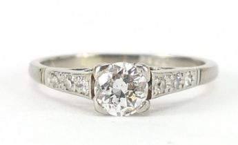 18ct white gold diamond solitaire ring with diamond shoulders, the central diamond approximately 4mm