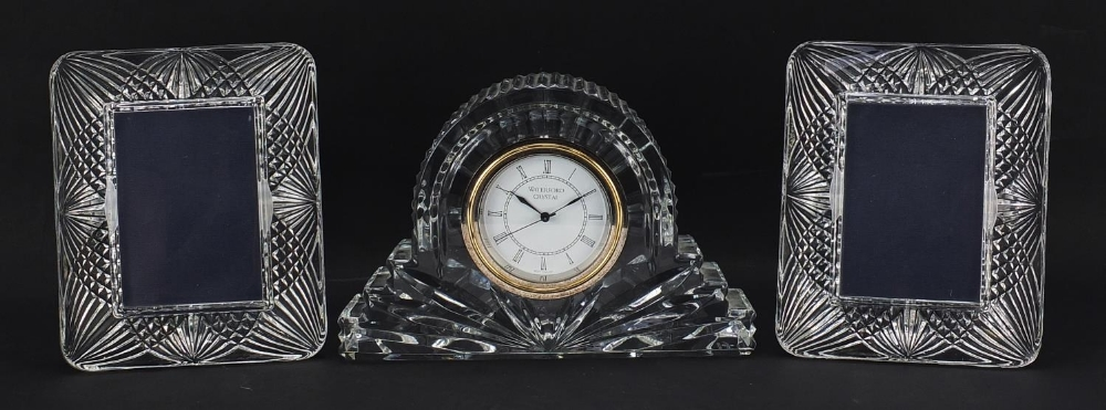 Waterford Crystal mantle clock and pair of French crystal photo frames, the largest 18.5cm wide :