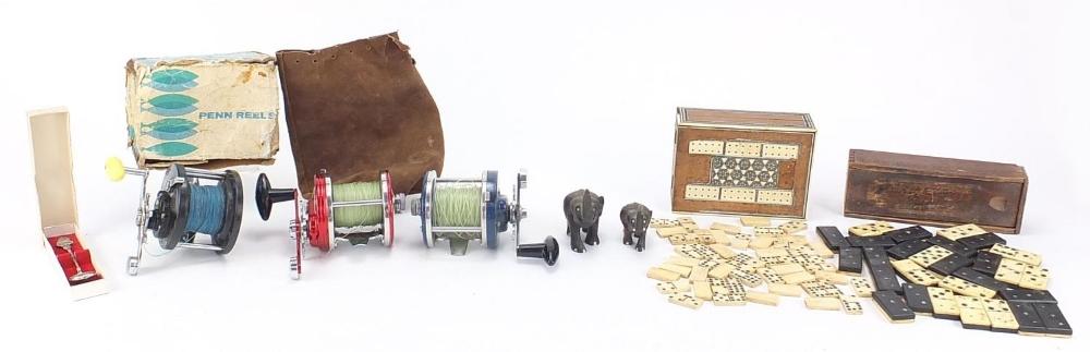 Sundry items including bone and ebony dominoes, fishing reels, Anglo Indian Vizagapatam folding