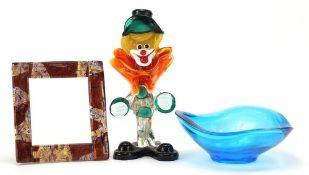 Glassware including a colourful Murano glass clown and a Murano millefiori photo frame, the