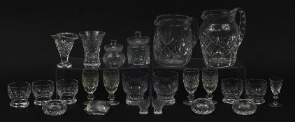 Cut glassware including four Waterford glasses, two jugs and balloon tumblers, the largest 18cm high