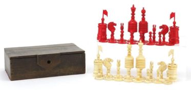 19th century half stained carved bone chess set, the largest pieces each 12cm high : For Further