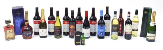 Sixteen bottles of alcohol including one litre bottle of Courvoisier cognac with box, Veuve