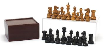 Antique boxwood and ebony Staunton pattern chess set with mahogany case, the largest pieces each 9cm