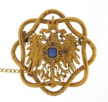 Unmarked gold Polish eagle with crown brooch set with sapphire and diamonds, housed in a Johann