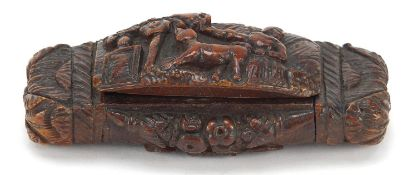 Antique coquilla nut snuff box carved with figure and dog beside a tree and an Irish rose, 10cm wide