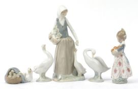 Nao and Lladro figures including girl feeding geese and a girl with a basket of oranges, the largest