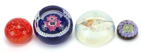 Four colourful glass paperweights including Caithness, Whitefriars Anemone and an opalescent bird