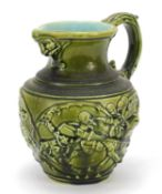 Sarreguemines, French Maiolica jug decorated in relief with figures, 18cm high : For Further