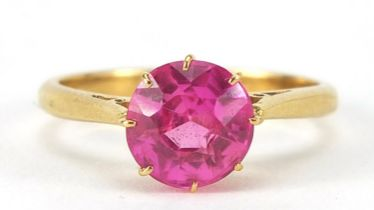 18ct gold ruby solitaire ring, the stone approximately 8mm in diameter, size N, 3.7g : For Further