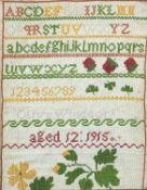 Vintage alphabet sampler by Olive Windsor, aged 12, 1915, details verso, mounted, framed and glazed,