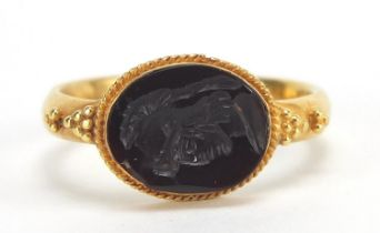 Antique unmarked gold intaglio seal ring carved with a gladiator head, (tests as 15ct+ gold) size Q,