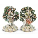 Pair of antique bocage groups modelled as male and female musicians in 18th century dress, both with