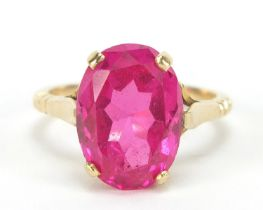 Unmarked gold ruby solitaire ring, the stone approximately 14.5mm x 10mm x approximately 6mm deep,