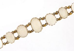 Antique unmarked gold graduated cabochon moonstone bracelet, 13cm in length, 7.6g : For Further