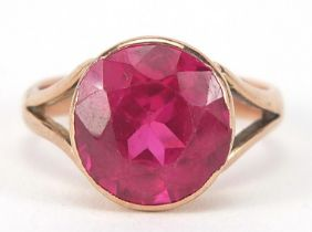 9ct rose gold ruby solitaire ring, the stone approximately 10mm in diameter, size H, 3.6g : For