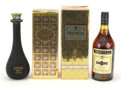 Three vintage bottles of cognac, two with boxes, one sealed, comprising Otard XO, Hennesey Very