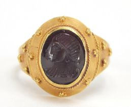Antique unmarked gold intaglio silver ring carved with a gladiator head, (tests as 15ct+) size M,