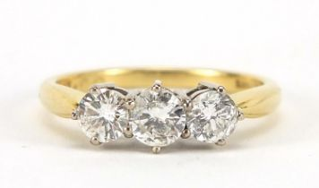 18ct gold diamond three stone ring, the central diamond approximately 4.2mm in diameter, size O, 3.