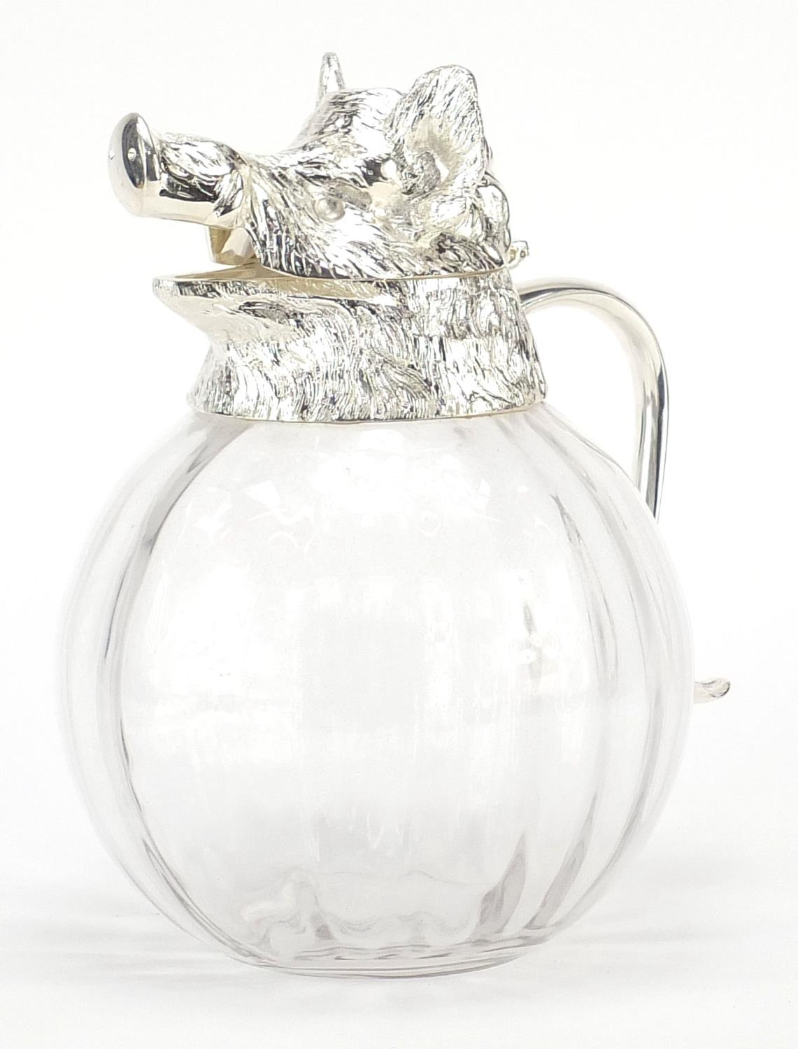 Manner of Valenti, globular glass carafe with silver plated mounts in the form of a boars head, 28cm