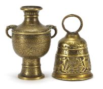 Islamic twin handled vase engraved with birds amongst flowers and a bronze bell, the largest 17.