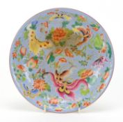 Chinese porcelain shallow dish hand painted in the famille rose palette with butterflies amongst