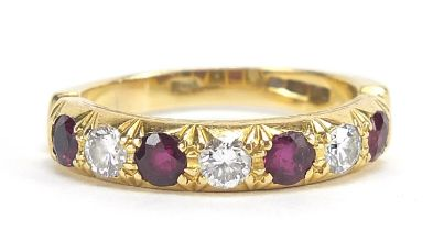 18ct gold diamond and ruby half eternity ring, the diamonds approximately 3.2mm in diameter, size R,