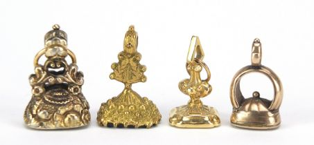Four Georgian and later unmarked gold and gold coloured metal intaglio seal fobs, the largest 2.
