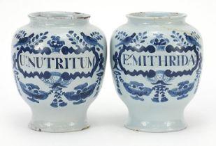 Two 18th century Delft blue and white tin glazed drug jars, 19cm high