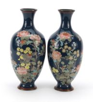 Pair of Japanese cloisonne vases enamelled with birds amongst flowers, each 25cm high
