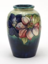 Large Moorcroft pottery vase hand painted with flowers, signature and marks to the base, 24cm high