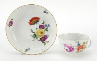 Meissen, 19th century porcelain cup and saucer hand painted with flowers, the saucer 13.5cm in