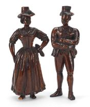 Pair of antique continental wood carvings of peasants in 18th century dress, the largest 22cm high