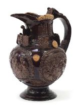 Large brown glazed pottery Essex jug with associated paperwork, 35cm high