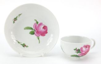 Meissen, 19th century porcelain cup and saucer hand painted with flowers, the saucer 14cm in